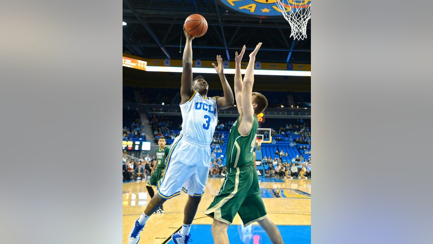 UCLA guard Jordan Adams, left, puts up a shot as Sacramento center Eric Stuteville defends during the first half of an NCAA college basketball game, Monday, Nov. 18, 2013, in Los Angeles.  (AP Photo/Mark J. Terrill)