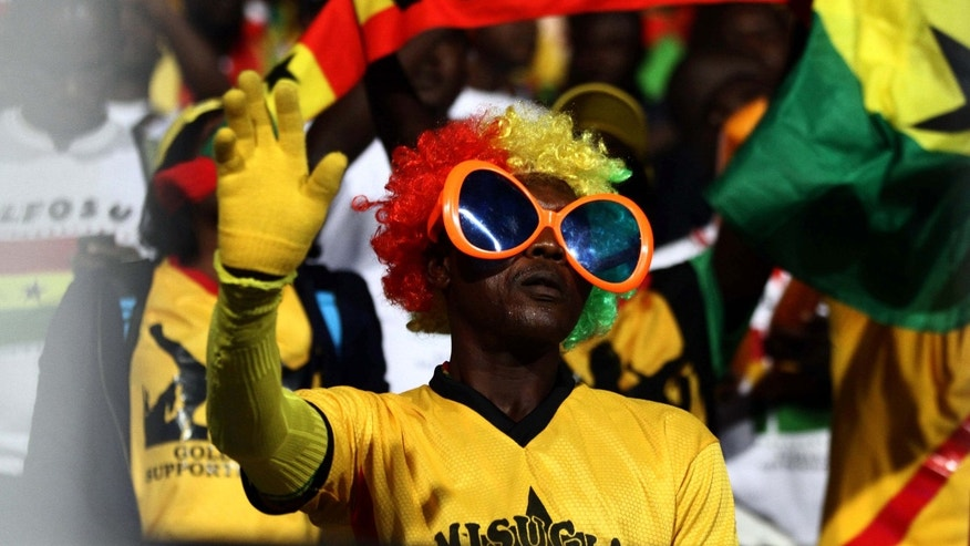 A Ghana fan wears the national colors during the World Cup qualifying playoff second leg soccer match between Ghana and Egypt, at the Air Defense Stadium in Cairo, Egypt, Tuesday, Nov. 19, 2013. Ghana qualified for the World Cup on Tuesday with a 7-3 aggregate win over Egypt in the playoffs to seize the fourth of five African places available at the finals. Egypt won the second leg 2-1 in the first international in Cairo in two years but Ghana progressed because of its 6-1 win at home in the first leg last month _ when Egypt's dream of making a World Cup for the first time since 1990 effectively ended.  (AP Photo/Ahmed Gomaa)