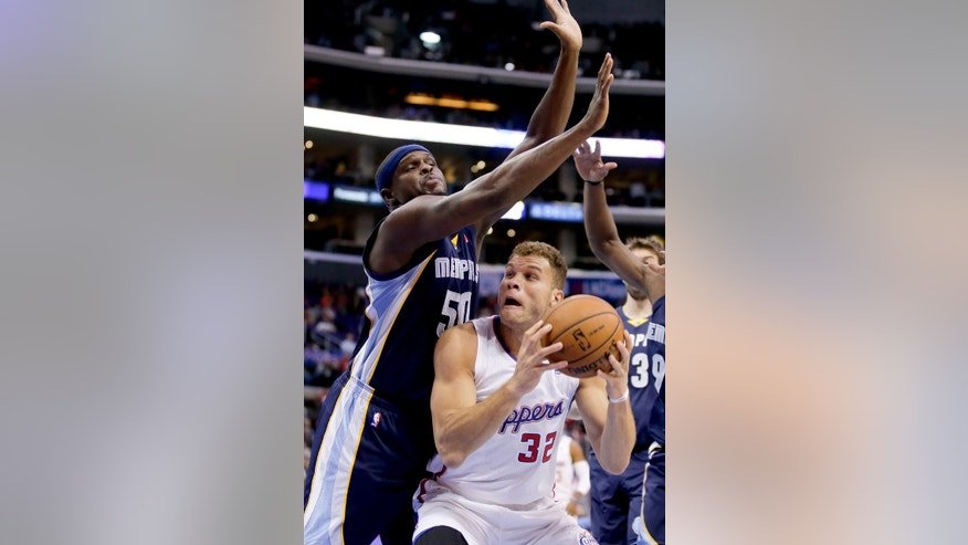 Los Angeles Clippers forward Blake Griffin, right, drives to the basket user Memphis Grizzlies forward Zach Randolph during the first half of an NBA basketball game in Los Angeles, Monday, Nov. 18, 2013. (AP Photo/Chris Carlson)