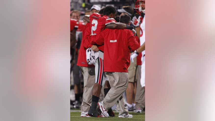 In this Sept. 28, 2013 photo, Ohio State defensive back Christian Bryant (2) is helped off the field after breaking his ankle against Wisconsin during an NCAA college football game in Columbus, Ohio. Now the Buckeyes' safety is just trying to rehab the ankle, hoping to either play in a bowl game or possibly even a fifth season if he gets a medical redshirt. (AP Photo/Paul Vernon)