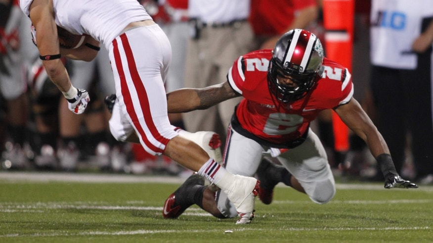 In this Sept. 28, 2013 photo, Ohio State defensive back Christian Bryant (2) attempts a tackle against Wisconsin during an NCAA college football game in Columbus, Ohio. Bryant's 2013 season came to an end on the next-to-last play against Wisconsin. Now the Buckeyes' safety is just trying to rehab a broken ankle, hoping to either play in a bowl game or possibly even a fifth season if he gets a medical redshirt. (AP Photo/Paul Vernon)