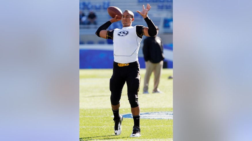 "File-This photo taken Nov. 9, 2013, shows Missouri quarterback James Franklin warming up before an NCAA college football game against Kentucky, Saturday, in Lexington, Ky. Coach Gary Pinkel said Monday Nov. 18, 2013,  that Franklin is ""100 percent cleared"" and will lead the eighth-ranked Tigers at Ole Miss this weekend after missing four starts with a sprained throwing shoulder. (AP Photo/James Crisp, File)"