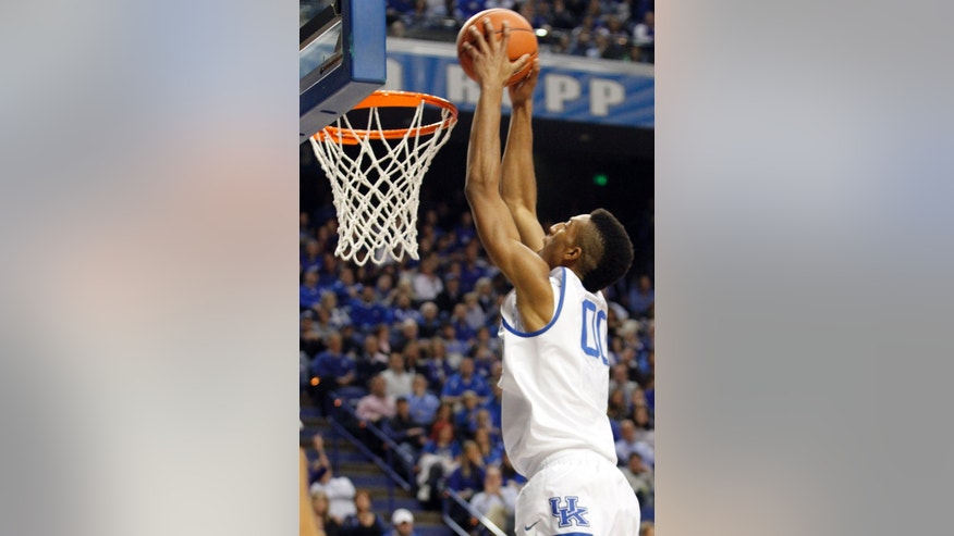 Kentucky's Marcus Lee dunks during the first half of an NCAA college basketball game against Texas-Arlington, Tuesday, Nov. 19, 2013, in Lexington, Ky. (AP Photo/James Crisp)