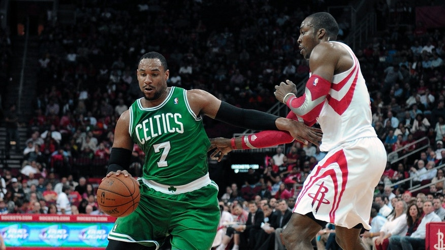 Boston Celtics' Jared Sullinger (7) drives the ball around Houston Rockets' Dwight Howard in the first half of an NBA basketball game Tuesday, Nov. 19, 2013, in Houston. (AP Photo/Pat Sullivan)