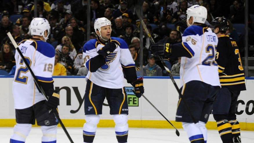 St. Louis Blues' Derek Roy (12) and Chris Stewart (25) celebrate a goal by Brenden Morrow (10) during the second period of an NHL hockey game against the Buffalo Sabres in Buffalo, N.Y., Tuesday, Nov. 19, 2013. (AP Photo/Gary Wiepert)