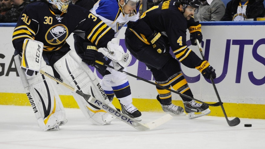 Buffalo Sabres'  Ryan Miller (30) battles behind the net with St. Louis Blues' Alexander Steen (20) while Sabres' Jamie McBain (4) carries the puck away during the second period of an NHL hockey game in Buffalo, N.Y., Tuesday, Nov. 19, 2013. (AP Photo/Gary Wiepert)