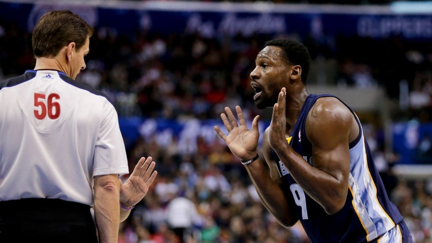 Memphis Grizzlies shooting guard Tony Allen, right, reacts after getting called for a foul by referee Mark Ayotte during the first half of an NBA basketball game in Los Angeles, Monday, Nov. 18, 2013. (AP Photo/Chris Carlson)