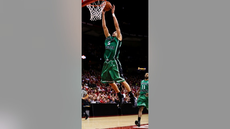 On a fast break North Dakota's Troy Huff dunks against Wisconsin during the first half of an NCAA college basketball game Tuesday, Nov. 19, 2013, in Madison, Wis. (AP Photo/Andy Manis)