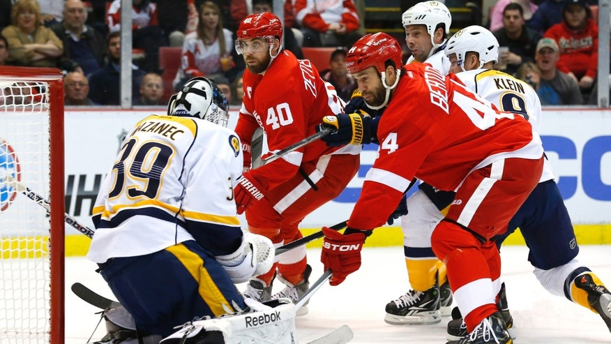 Nashville Predators goalie Marek Mazanec (39) stops a Detroit Red Wings right wing Todd Bertuzzi's (44) shot in the second period of an NHL hockey game in Detroit, Tuesday, Nov. 19, 2013. (AP Photo/Paul Sancya)