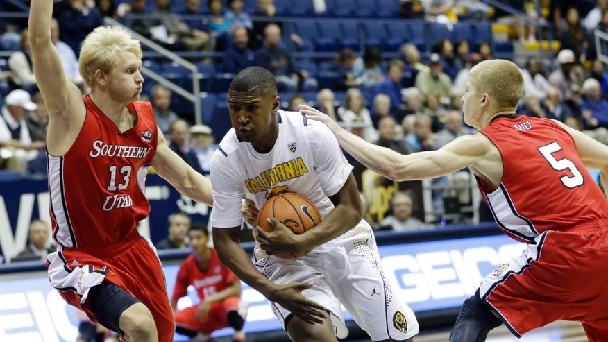 California's Jordan Mathews, center, drives to the basket between Southern Utah 's Race Parsons (13) and John Marshall (5) during the first half on an NCAA college basketball game on Monday, Nov. 18, 2013, in Berkeley, Calif. (AP Photo/Marcio Jose Sanchez)