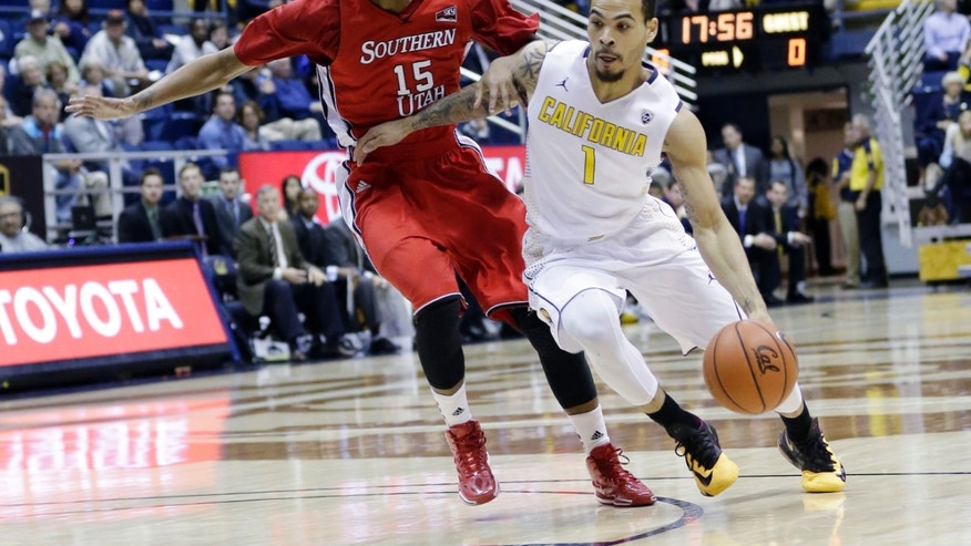 California 's Justin Cobbs (1) dribbles next to Southern Utah 's Juwan Major (15) during the first half on an NCAA college basketball game on Monday, Nov. 18, 2013, in Berkeley, Calif. (AP Photo/Marcio Jose Sanchez)