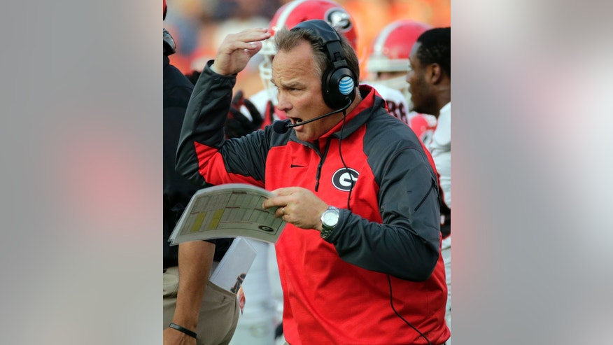 Georgia head coach Mark Richt yells instructions to his team during the first half of an NCAA college football game against Auburn in Auburn, Ala., Saturday, Nov. 16, 2013. (AP Photo/Dave Martin)
