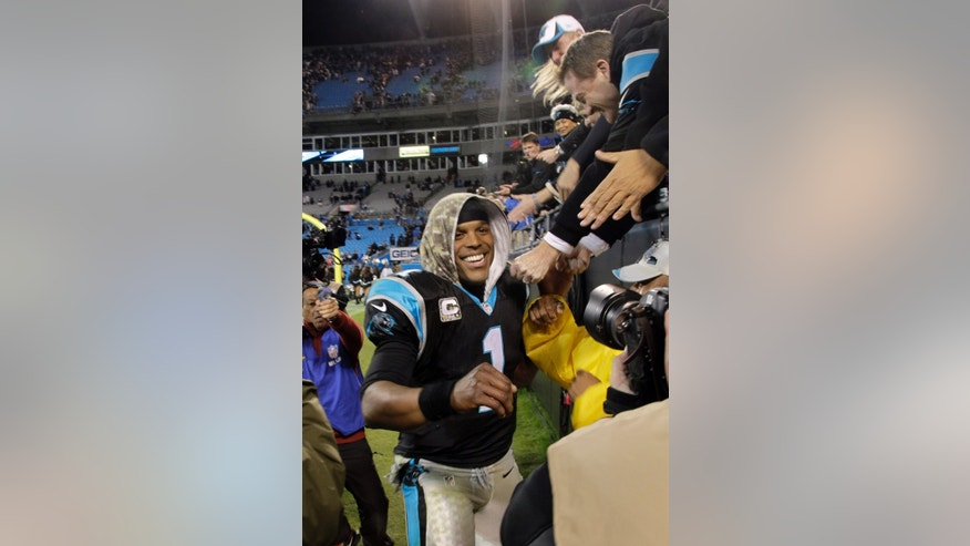 Carolina Panthers' Cam Newton (1) celebrates after the Panthers' 24-20 win over the New England Patriots in an NFL football game in Charlotte, N.C., Monday, Nov. 18, 2013. (AP Photo/Bob Leverone)