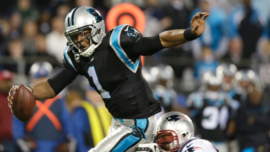 Carolina Panthers' Cam Newton (1) avoids a sack by a New England Patriots defender during the second half of an NFL football game in Charlotte, N.C., Monday, Nov. 18, 2013. (AP Photo/Bob Leverone)