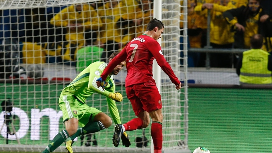 Portugal's Cristiano Ronaldo, right, runs before scoring his third goal during the World Cup qualifying playoff second leg soccer match between Sweden and Portugal in Stockholm, Sweden, Tuesday, Nov.19, 2013. (AP Photo/Frank Augstein)