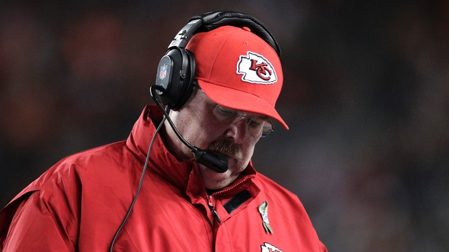 Kansas City Chiefs coach Andy Reid looks down at his play list against the Denver Broncos in the fourth quarter of an NFL football game, Sunday, Nov. 17, 2013, in Denver. (AP Photo/Joe Mahoney)