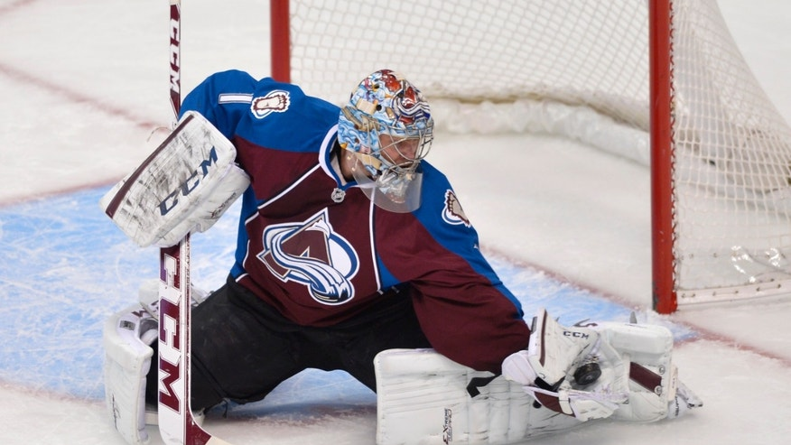 Colorado Avalanche goalie Semyon Varlamov (1) from Russia makes a glove save against the Chicago Blackhawks during the first period of an NHL hockey game Tuesday, Nov. 19, 2013, in Denver. (AP Photo/Jack Dempsey)