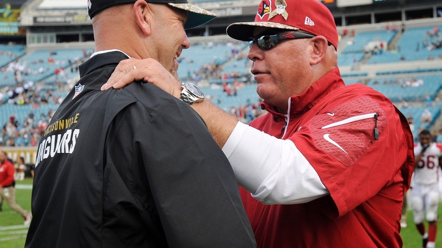 Arizona Cardinals head coach Bruce Arians, right, shakes hands with Jacksonville Jaguars head coach Gus Bradley at the end of an NFL football game on Sunday, Nov. 17, 2013, in Jacksonville, Fla. The Cardinals defeated the Jaguars 27-14. (AP Photo/Stephen Morton)