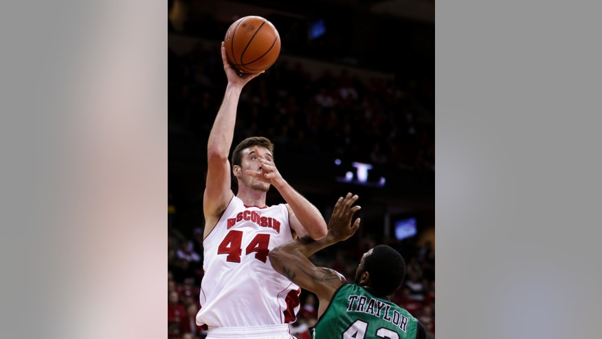Wisconsin's Frank Kaminsky (44) shoots past North Dakota's Alonzo Traylor during the second half of an NCAA college basketball game Tuesday, Nov. 19, 2013, in Madison, Wis. Kaminsky set school single-game record of 43 points in Wisconsin's 103-85 win.  (AP Photo/Andy Manis)