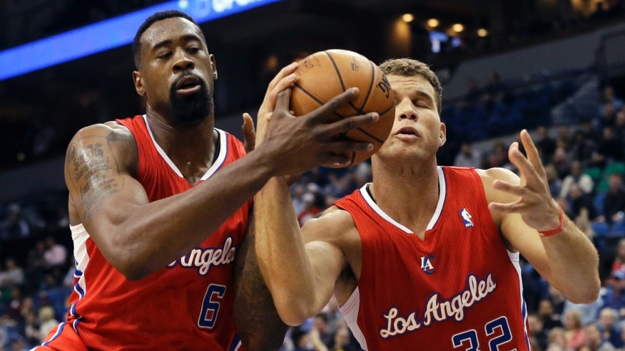 Los Angeles Clippers' DeAndre Jordan, left, and Blake Griffin share in a rebound in the first quarter of an NBA basketball game against the Minnesota Timberwolves, Wednesday, Nov. 20, 2013, in Minneapolis. (AP Photo/Jim Mone)