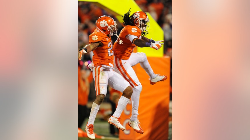 Clemson's Sammy Watkins, right, and Roderick McDowell celebrate Watkin's touchdown during the second half of an NCAA college football game against Georgia Tech, Thursday, Nov. 14, 2013, in Clemson, S.C. Clemson won 55-31. (AP Photo/ Richard Shiro)