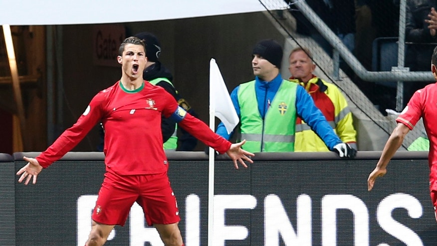 Portugal's Cristiano Ronaldo celebrates scoring the opening goal during the World Cup qualifying playoff second leg soccer match between Sweden and Portugal in Stockholm, Sweden, Tuesday, Nov.19, 2013. (AP Photo/Frank Augstein)