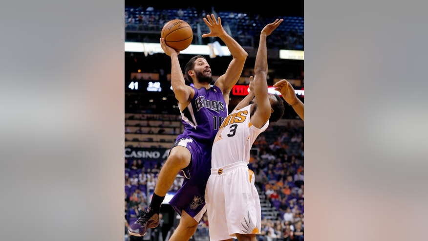 Sacramento Kings' Greivis Vasquez (10), of Venezuela, tries to drive past Phoenix Suns' Ish Smith (3) during the first half of an NBA basketball game Wednesday, Nov. 20, 2013, in Phoenix. (AP Photo/Ross D. Franklin)