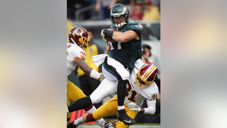 Philadelphia Eagles' Brent Celek fights for the extra yard during an NFL football game against the Washington Redskins in Philadelphia, Sunday, Nov. 17, 2013. (AP Photo/The News-Journal, Andre L. Smith) NO SALES