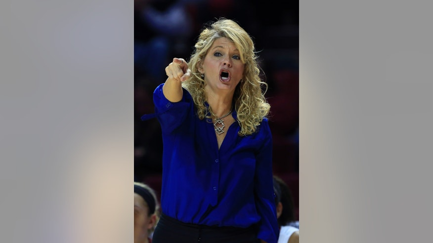 Oklahoma head coach Sherri Coale yells to her team as they play UT Arlington during the first half of a NCAA college basketball game in Norman, Okla., Wednesday, Nov. 20, 2013. (AP Photo/Alonzo Adams)
