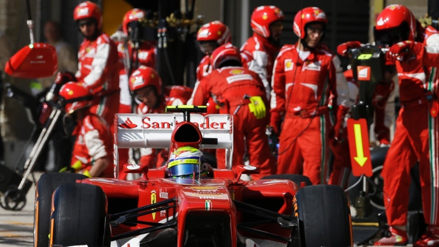 Ferrari driver Felipe Massa of Brazil leaves the pits after a stop during the Formula One U.S. Grand Prix auto race at the Circuit of the Americas, Sunday, Nov. 17, 2013, in Austin, Texas. (AP Photo/Darron Cummings)