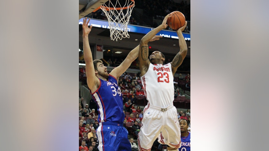 Ohio State's Amir Williams, right, shoots over American's Tony Wroblicky during the first half of an NCAA college basketball game on Wednesday, Nov. 20, 2013, in Columbus, Ohio. (AP Photo/Jay LaPrete)