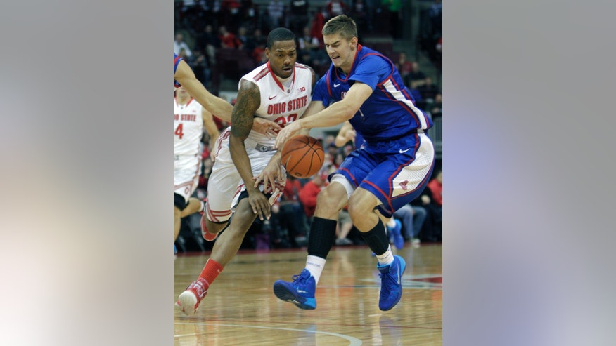 American's Kyle Kager, right, steals the ball from Ohio State's Lenzelle Smith during the first half of an NCAA college basketball game on Wednesday, Nov. 20, 2013, in Columbus, Ohio. (AP Photo/Jay LaPrete)