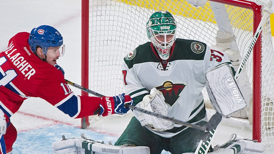 Minnesota Wild's goaltender Josh Harding makes a save against Montreal Canadiens' Brendan Gallagher during the second period of an NHL hockey game, Tuesday, Nov. 19, 2013 in Montreal. (AP Photo/The Canadian Press, Graham Hughes)