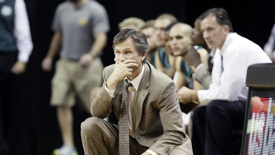 Utah Valley coach Dick Hunsaker watches from the bench during the second half of an NCAA college basketball game against Oregon  in Eugene, Ore., Tuesday, Nov. 19, 2013. Oregon beat Utah Valley 69-54. (AP Photo/Don Ryan)
