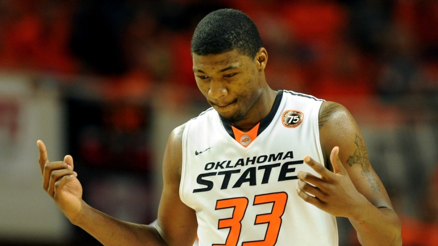 Oklahoma State guard Marcus Smart celebrates after being fouled during the second half of an NCAA college basketball game in Stillwater, Okla., Tuesday, Nov. 19, 2013. Smart set a personal scoring record with 39 points in the 101-80 win over Memphis. (AP Photo/Brody Schmidt)