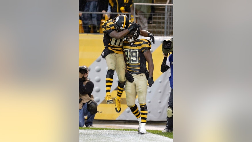 Pittsburgh Steelers wide receiver Jerricho Cotchery (89) is celebrates with teammate Markus Wheaton (11) after making a touchdown catch in the fourth quarter of an NFL football game in Pittsburgh, Sunday, Nov. 17, 2013. (AP Photo/Gene J. Puskar)