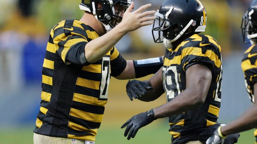 Pittsburgh Steelers quarterback Ben Roethlisberger (7) celebrates with wide receiver Jerricho Cotchery (89) after they connected for a fourth quarter touchdown pass in an NFL football game against the Detroit Lions  in Pittsburgh, Sunday, Nov. 17, 2013. (AP Photo/Gene J. Puskar)