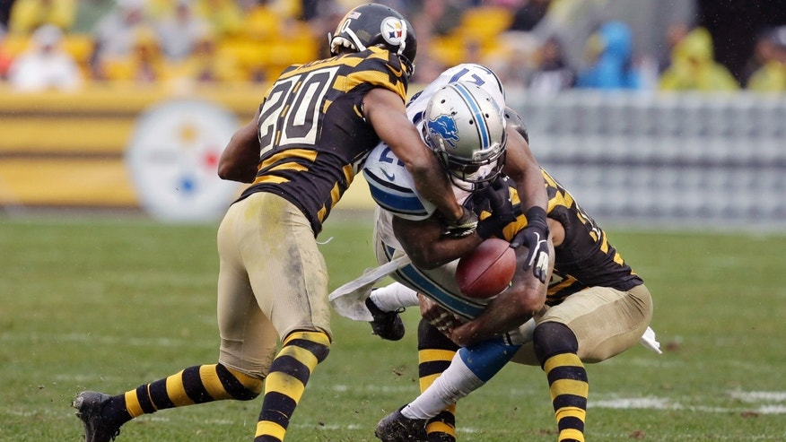 Detroit Lions running back Reggie Bush (21) loses the football as Pittsburgh Steelers strong safety Will Allen (20) and free safety Ryan Clark (25) hit him in the first half of an NFL football game in Pittsburgh, Sunday, Nov. 17, 2013. The play was called dead on an early whistle and no fumble was ruled. (AP Photo/Gene J. Puskar)
