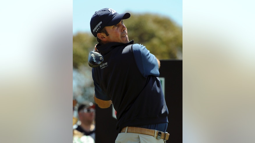 Matt Kuchar of the U.S. tees off during the final round of the Australian Masters golf tournament at Royal Melbourne Golf Course in Australia, Sunday, Nov. 17, 2013.  Kuchar finished second to Australia's Adam Scott.  (AP Photo/Andy Brownbill)