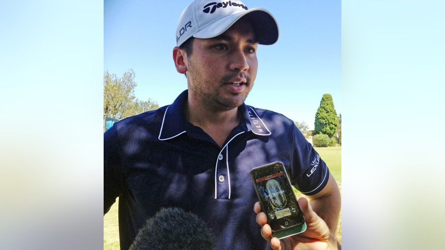 Australian golfer Jason Day comments to journalists at Royal Melbourne golf course in Melbourne, Australia, Monday, Nov. 18, 2013. Day has confirmed that eight of his relatives died in Typhoon Haiyan in the Philippines, including his grandmother. (AP Photo/Dennis Passa)
