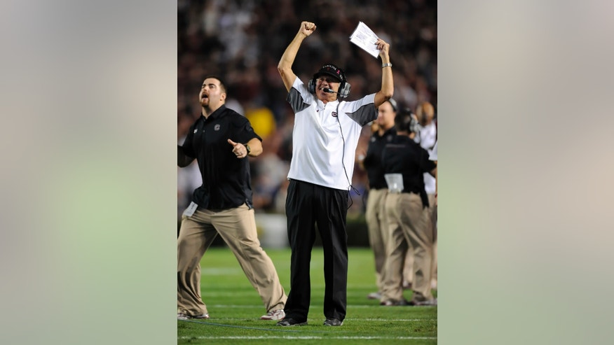 South Carolina coach Steve Spurrier reacts after Elliott Fry scored the go-ahead field goal during the second half of an NCAA college football game against Florida on Saturday, Nov. 16, 2013, at Williams-Brice Stadium in Columbia, S.C. South Carolina won 19-14. (AP Photo/ Richard Shiro)