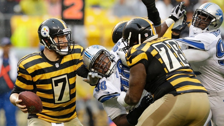 Pittsburgh Steelers quarterback Ben Roethlisberger (7) is pressured by the rush of Detroit Lions defensive tackle Nick Fairley (98) and Detroit Lions defensive end Devin Taylor (92) during the third quarter of an NFL football game in Pittsburgh, Sunday, Nov. 17, 2013. (AP Photo/Gene J. Puskar)