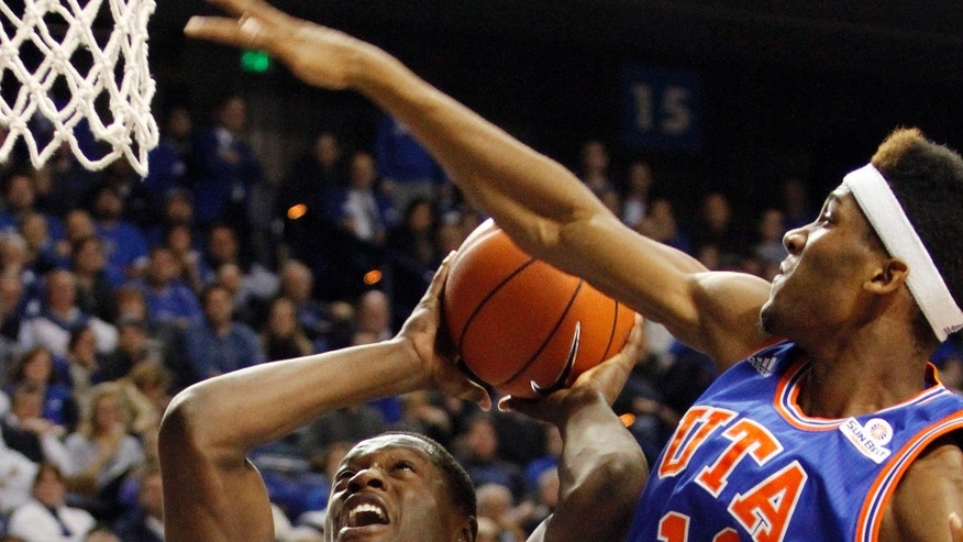Kentucky's Julius Randle (30) shoots under pressure from Texas-Arlington's Brandon Williams (11) during the second half of an NCAA college basketball game, Tuesday, Nov. 19, 2013, in Lexington, Ky. Kentucky won 105-76. (AP Photo/James Crisp)