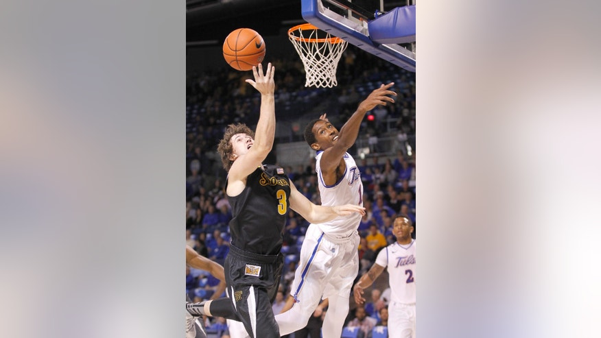 Wichita State's Ron Baker, left, and Tulsa's Rashad Smith battle for a rebound during the first half of an NCAA college basketball game in Tulsa, Okla., Wednesday, Nov. 20, 2013. (AP Photo/Dave Crenshaw)