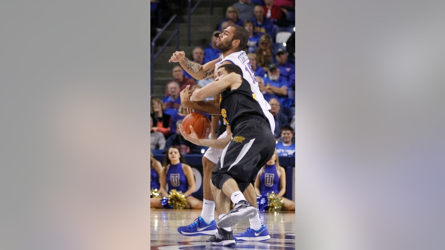 Wichita State's Fred VanVleet, front, and Tulsa's Marquel Curtis battle over a loose ball during the second half of an NCAA college basketball game in Tulsa, Okla., Wednesday, Nov. 20, 2013. Wichita State won 77-54. (AP Photo/Dave Crenshaw)