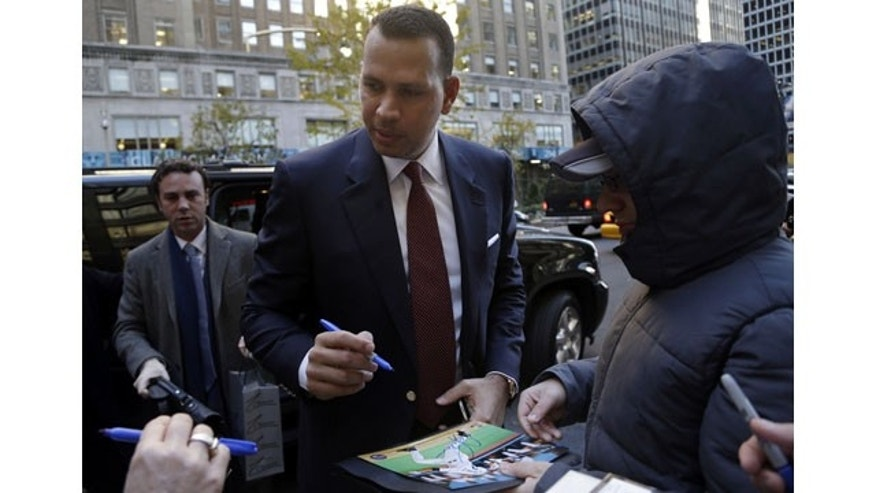 November 19, 2013: Alex Rodriguez signs autographs as he arrives at Major League Baseball headquarters in New York. Rodriguez's grievance hearing to overturn his 211-game suspension resumed Monday with the first of what could be 10 straight days of sessions. (AP Photo/Seth Wenig)