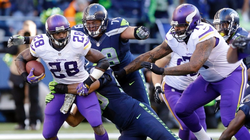 Seattle Seahawks' Red Bryant (79) pursues Minnesota Vikings' Adrian Peterson who is tackled on a carry in the first half of an NFL football game Sunday, Nov. 17, 2013, in Seattle. (AP Photo/Ted S. Warren)
