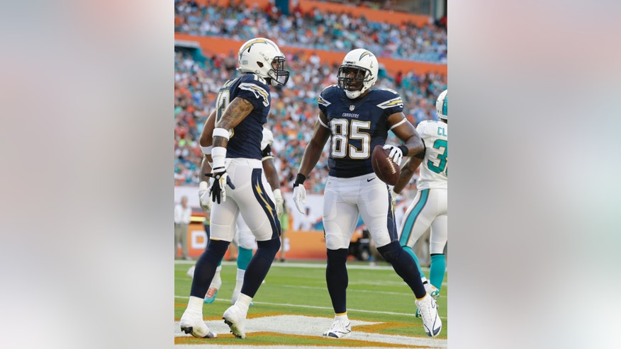 San Diego Chargers tight end Antonio Gates (85) is congratulated by wide receiver Keenan Allen (13) after scoring a touchdown during the first half of an NFL football game against the Miami Dolphins, Sunday, Nov. 17, 2013, in Miami Gardens, Fla. (AP Photo/Lynne Sladky)