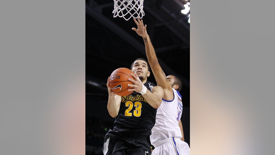 Wichits State's Fred VanVleet, left, drives to the basket against Tulsa's Marquel Curtis during the second half of an NCAA college basketball game in Tulsa, Okla., Wednesday, Nov. 20, 2013. WIchita State won 77-54. (AP Photo/Dave Crenshaw)