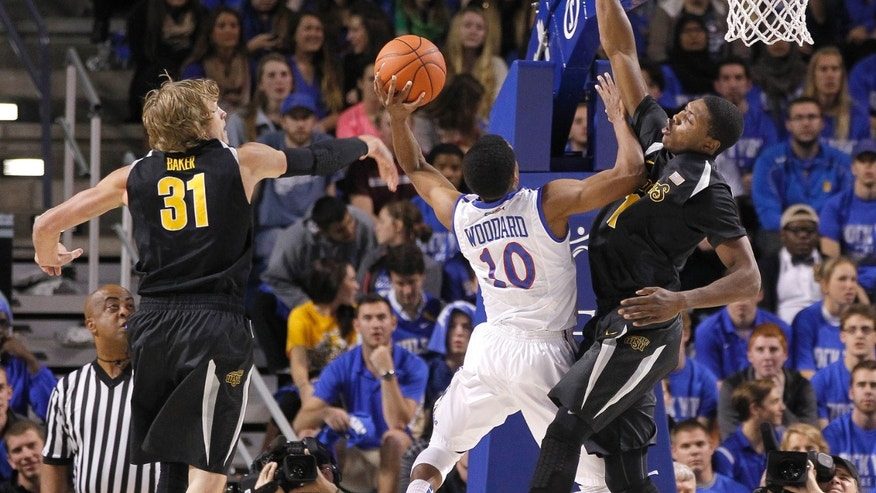 Tulsa's James Woodward, second from right, drives to basket as Wichita State's Ron Baker (31) and Cleanthony Early, right, defends during the first half of an NCAA college basketball game in Tulsa, Okla., Wednesday, Nov. 20, 2013. (AP Photo/Dave Crenshaw)